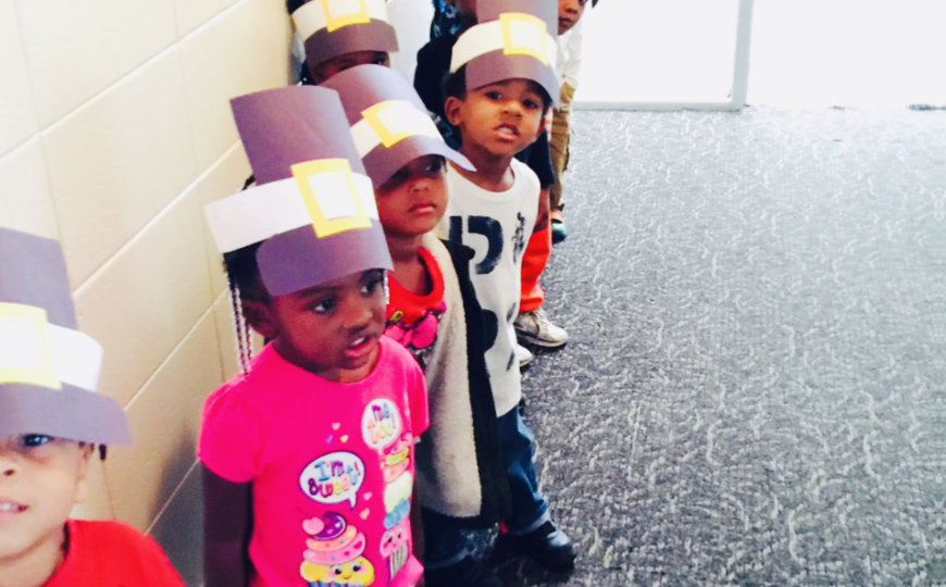 Children wearing paper cap